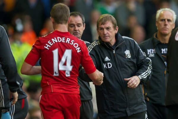 LIVERPOOL, ENGLAND - Saturday, September 24, 2011: Liverpool's manager Kenny Dalglish shakes hands with Jordan Henderson as he is substituted against Wolverhampton Wanderers during the Premiership match at Anfield. (Pic by David Rawcliffe/Propaganda)
