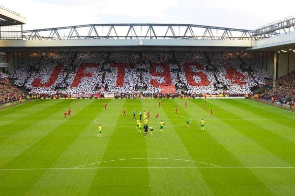 LIVERPOOL, ENGLAND - Saturday, October 22, 2011: Liverpool supporters on the famous Spion Kop hold up a mosaic reading JFT96 calling for Justice for the 96 before the Premiership match against Norwich City at Anfield. The fans are backing a campaign for the families of the 96 victims of the Hillsborough Stadium Disaster in 1989 who have waited over 22 years for Justice. (Pic by Vegard Grott/Propaganda)