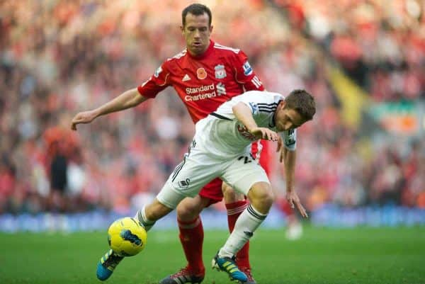 LIVERPOOL, ENGLAND - Saturday, November 5, 2011: Liverpool's Charlie Adam in action against Swansea City's Joe Allen during the Premiership match at Anfield. (Pic by David Rawcliffe/Propaganda)