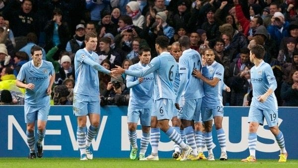 MANCHESTER, ENGLAND - Wednesday, December 7, 2011: Manchester City's Edin Dzeko and Joleon Lescott celebrate their side's first goal against FC Bayern Munchen during the UEFA Champions League Group A match at the City of Manchester Stadium. (Pic by Vegard Grott/Propaganda)