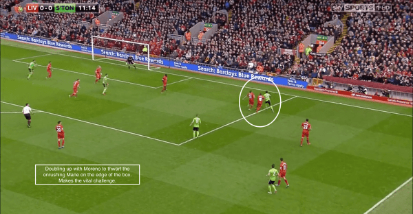 Doubling up with Moreno to thwart the onrushing Mane on the edge of the box. Makes the vital challenge.