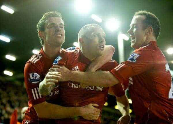 LIVERPOOL, ENGLAND - Wednesday, January 25, 2012: Liverpool's Craig Bellamy celebrates scoring the second goal against Manchester City with team-mates Jordan Henderson and Charlie Adam during the Football League Cup Semi-Final 2nd Leg at Anfield. (Pic by David Rawcliffe/Propaganda)