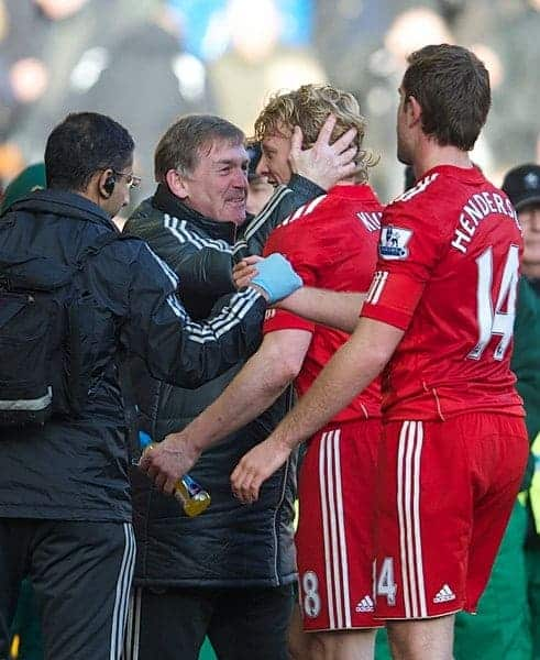 LIVERPOOL, ENGLAND - Saturday, January 28, 2012: Liverpool's manager Kenny Dalglish celebrates with match-winner Dirk Kuyt after the 2-1 victory over Manchester United during the FA Cup 4th Round match at Anfield. (Pic by David Rawcliffe/Propaganda)