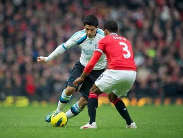 MANCHESTER, ENGLAND - Saturday, February 11, 2012: Liverpool's Luis Alberto Suarez Diaz takes on Manchester United's Patrice Evra during the Premiership match at Old Trafford. (Pic by David Rawcliffe/Propaganda)