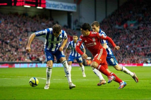 LIVERPOOL, ENGLAND - Saturday, February 19, 2012: Liverpool's Luis Alberto Suarez Diaz in action against Brighton & Hove Albion's Ashley Barnes and Gordon Greer during the FA Cup 5th Round match at Anfield. (Pic by David Rawcliffe/Propaganda)