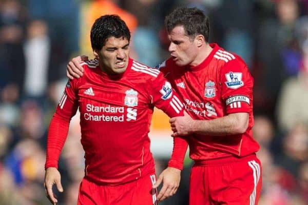 LIVERPOOL, ENGLAND - Saturday, March 3, 2012: Liverpool's Luis Alberto Suarez Diaz and Jamie Carragher against Arsenal during the Premiership match at Anfield. (Pic by David Rawcliffe/Propaganda)