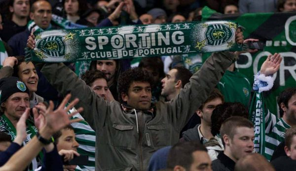 MANCHESTER, ENGLAND - Thursday, March 15, 2012: Sporting Clube de Portugal fans celebrate their side's victory over Manchester City during the UEFA Europa League Round of 16 2nd Leg match at City of Manchester Stadium. (Pic by Vegard Grott/Propaganda)