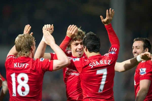LONDON, ENGLAND - Wednesday, March 21, 2012: Liverpool's Sebastian Coates celebrates scoring his first ever goal for the club, with team-mates Dirk Kuyt and Luis Alberto Suarez Diaz, during the Premiership match against Queens Park Rangers at Loftus Road. (Pic by David Rawcliffe/Propaganda)