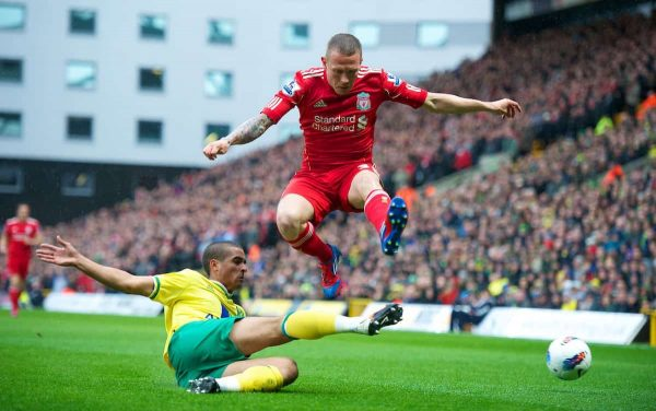 NORWICH, ENGLAND - Saturday, April 28, 2012: Liverpool's Craig Bellamy in action against Norwich City's Kyle Naughton during the Premiership match at Carrow Road. (Pic by David Rawcliffe/Propaganda)