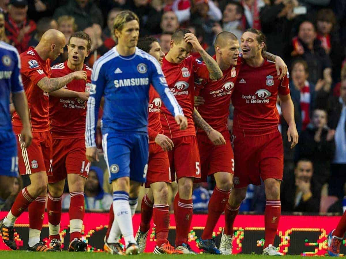 LIVERPOOL, ENGLAND - Tuesday, May 8, 2012: Liverpool's Daniel Agger celebrates scoring the third goal as Chelsea's Fernando Torres looks dejected during the final home Premiership match of the season at Anfield. (Pic by David Rawcliffe/Propaganda)