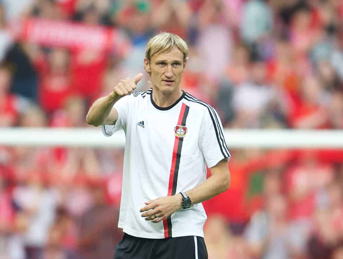 LIVERPOOL, ENGLAND - Sunday, August 12, 2012: Bayer 04 Leverkusen's manager Sami Hyypia applauds the supporters after his side's 3-1 defeat by former club Liverpool during a preseason friendly match at Anfield. (Pic by David Rawcliffe/Propaganda)