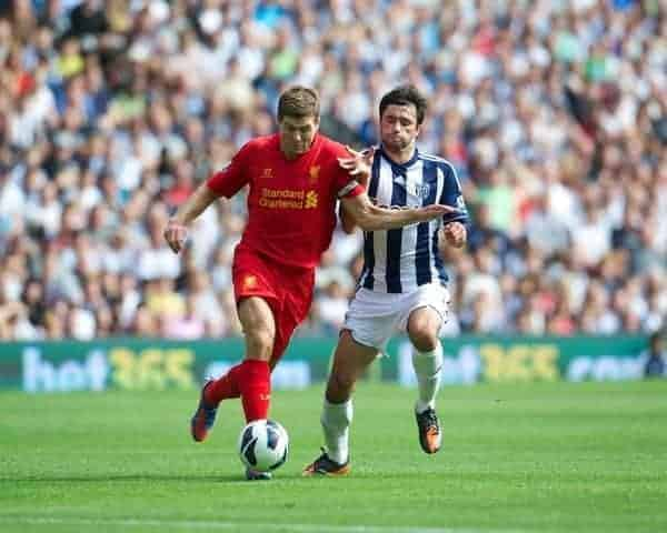 WEST BROMWICH, ENGLAND - Saturday, August 18, 2012: Liverpool's captain Steven Gerrard in action against West Bromwich Albion's Claudio Yacob during the opening Premiership match of the season at the Hawthorns. (Pic by David Rawcliffe/Propaganda)