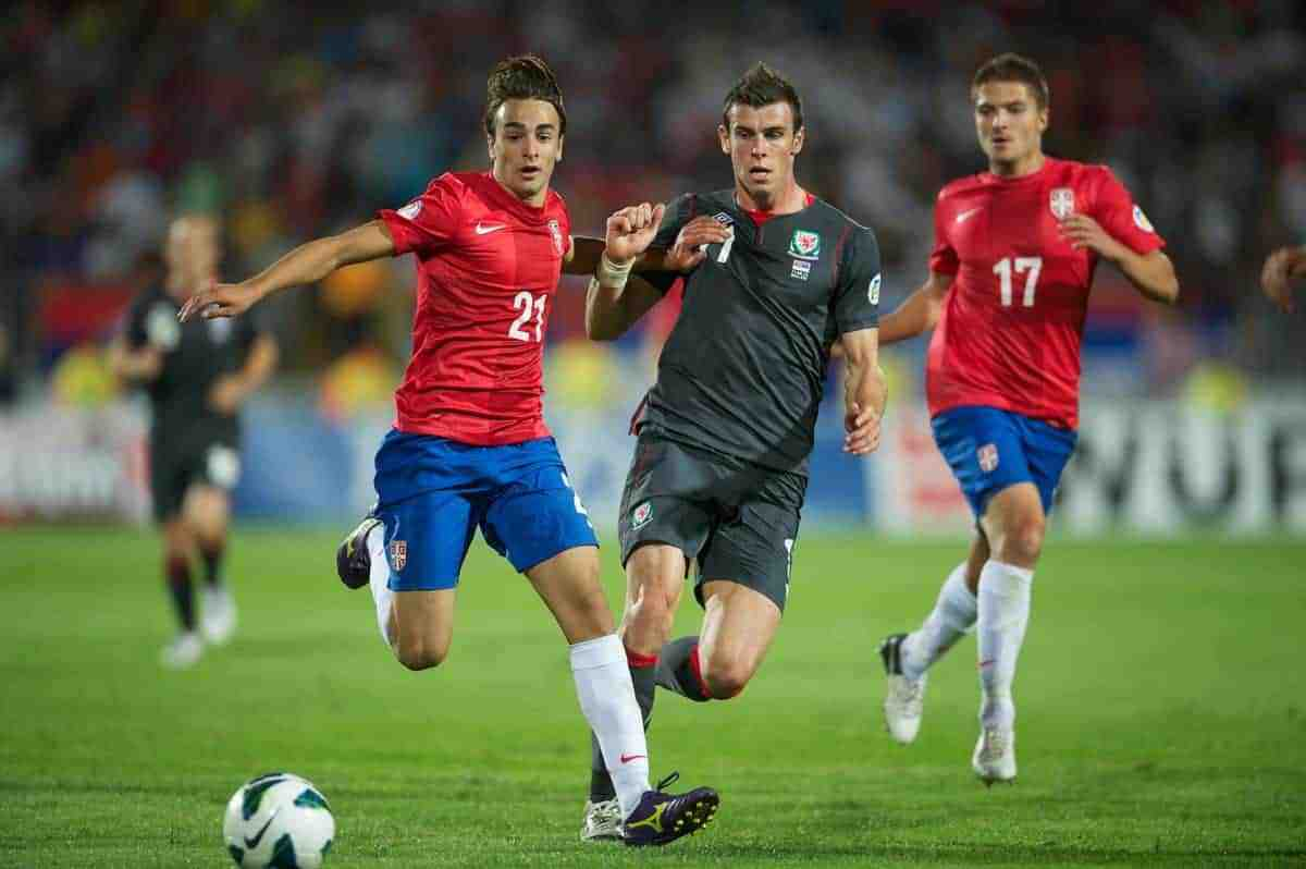 NOVI SAD, SERBIA - Tuesday, September 11, 2012: Wales' Gareth Bale in action against Serbia's Lazar Markovic during the 2014 FIFA World Cup Brazil Qualifying Group A match at the Karadorde Stadium. (Pic by David Rawcliffe/Propaganda)