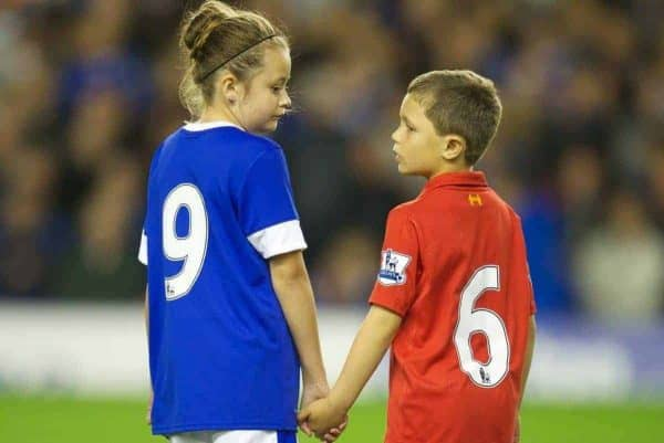 Mascots Beth Garner-Watt, 11, and Mikey Clarke, 8, stand for a minute's applause to remember the 96 victims of the Hillsborough Stadium Disaster before the Premiership match between Everton and Newcastle United at Goodison Park. (Pic by David Rawcliffe/Propaganda)