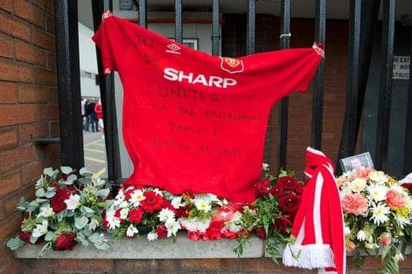 LIVERPOOL, ENGLAND - Sunday, September 23, 2012: A Manchester United shirt with a tribute for the 96 victims of the Hillsborough Stadium Disaster left on the gates of Anfield before the Premiership match between Liverpool and Manchester United. The release of the Hillsborough Independent Panel's report shed light on one of the biggest cover-up's in British history which sought to deflect blame from the Police onto the Liverpool supporters. (Pic by David Rawcliffe/Propaganda)
