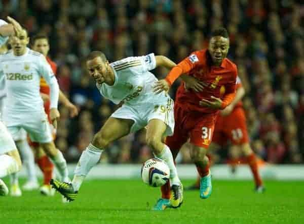 LIVERPOOL, ENGLAND - Wednesday, October 31, 2012: Liverpool's Raheem Sterling in action against Swansea City's Ashley 'Jazz' Richards during the Football League Cup 4th Round match at Anfield. (Pic by David Rawcliffe/Propaganda)