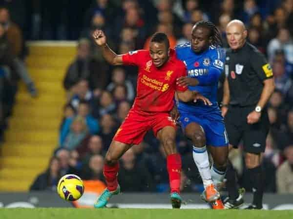 LONDON, ENGLAND - Sunday, November 11, 2012: Liverpool's Raheem Sterling in action against Chelsea's Victor Moses during the Premiership match at Stamford Bridge. (Pic by David Rawcliffe/Propaganda)