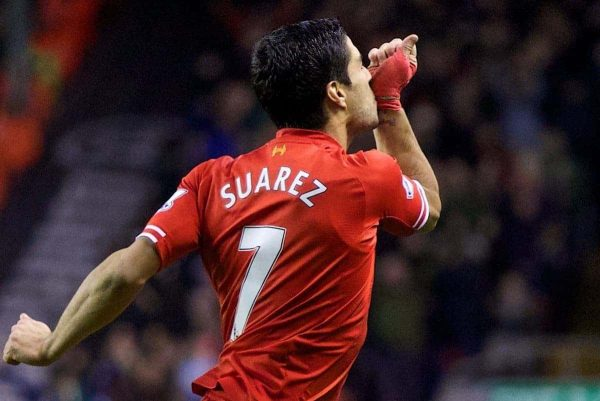 LIVERPOOL, ENGLAND - Wednesday, January 1, 2014: Liverpool's Luis Suarez celebrates scoring the second goal against Hull City during the Premiership match at Anfield. (Pic by David Rawcliffe/Propaganda)