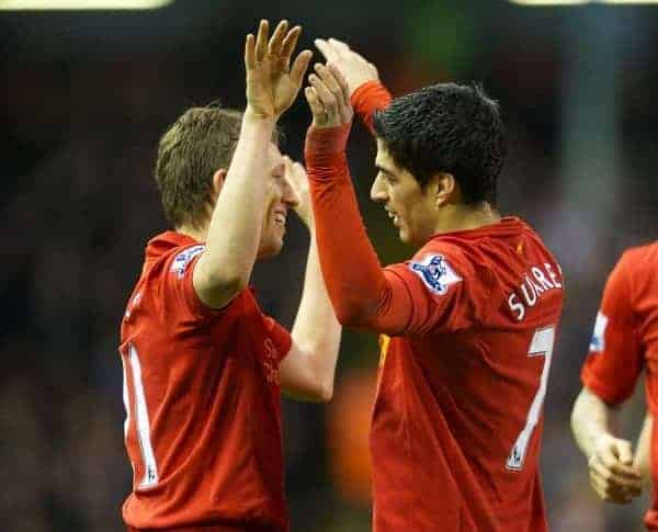 LIVERPOOL, ENGLAND - Wednesday, January 2, 2013: Liverpool's Luis Alberto Suarez Diaz celebrates scoring the third goal against Sunderland with team-mate Lucas Leiva during the Premiership match at Anfield. (Pic by David Rawcliffe/Propaganda)