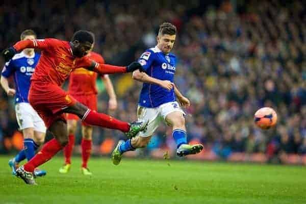 LIVERPOOL, ENGLAND - Sunday, January 5, 2014: Liverpool's Kolo Toure in action against Oldham Athletic's Michael Petrasso during the FA Cup 3rd Round match at Anfield. (Pic by David Rawcliffe/Propaganda)