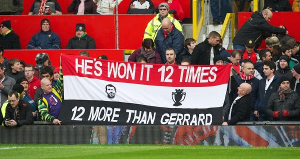 MANCHESTER, ENGLAND - Sunday, January 13, 2013: Manchester United fans' banner 'He's [Ryan Giggs] Won It 12 Times More Than Gerrard' during the Premiership match at Old Trafford. (Pic by David Rawcliffe/Propaganda)