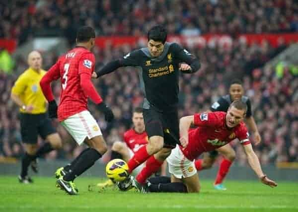 MANCHESTER, ENGLAND - Sunday, January 13, 2013: Liverpool's Luis Alberto Suarez Diaz has his shorts pulled back by Manchester United's Nemanja Vidic but no penalty was awarded by referee Howard Webb during the Premiership match at Old Trafford. (Pic by David Rawcliffe/Propaganda)