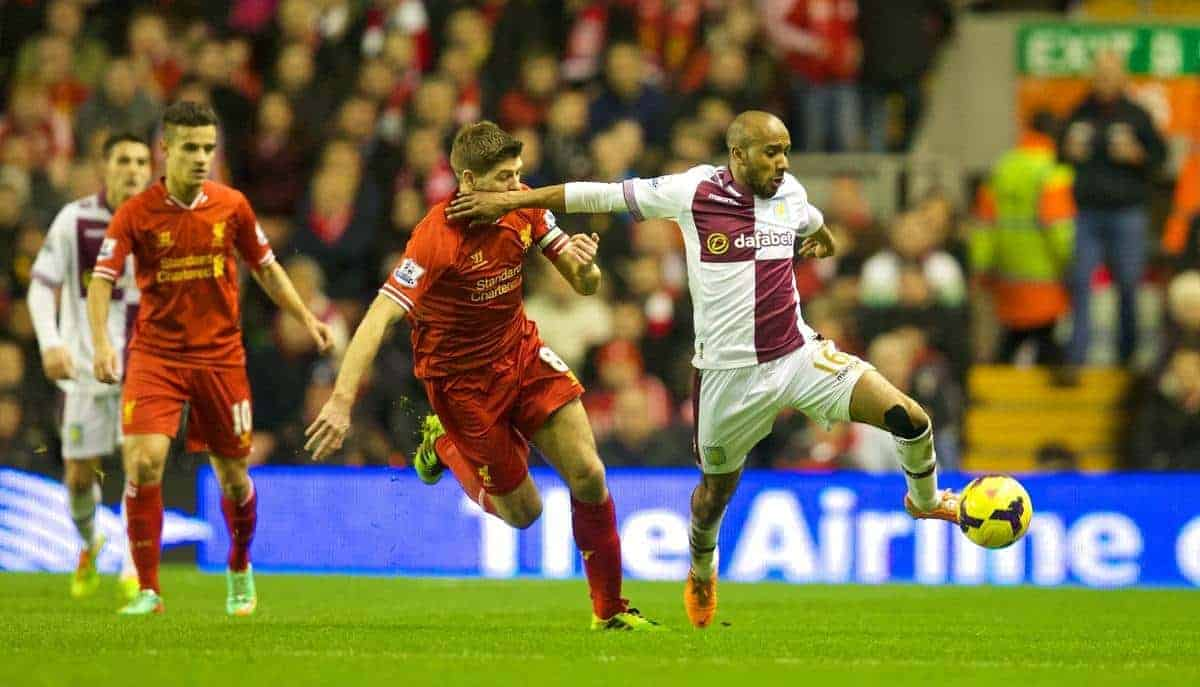 LIVERPOOL, ENGLAND - Saturday, January 18, 2014: Liverpool's captain Steven Gerrard and Aston Villa's Fabian Delph during the Premiership match at Anfield. (Pic by David Rawcliffe/Propaganda)