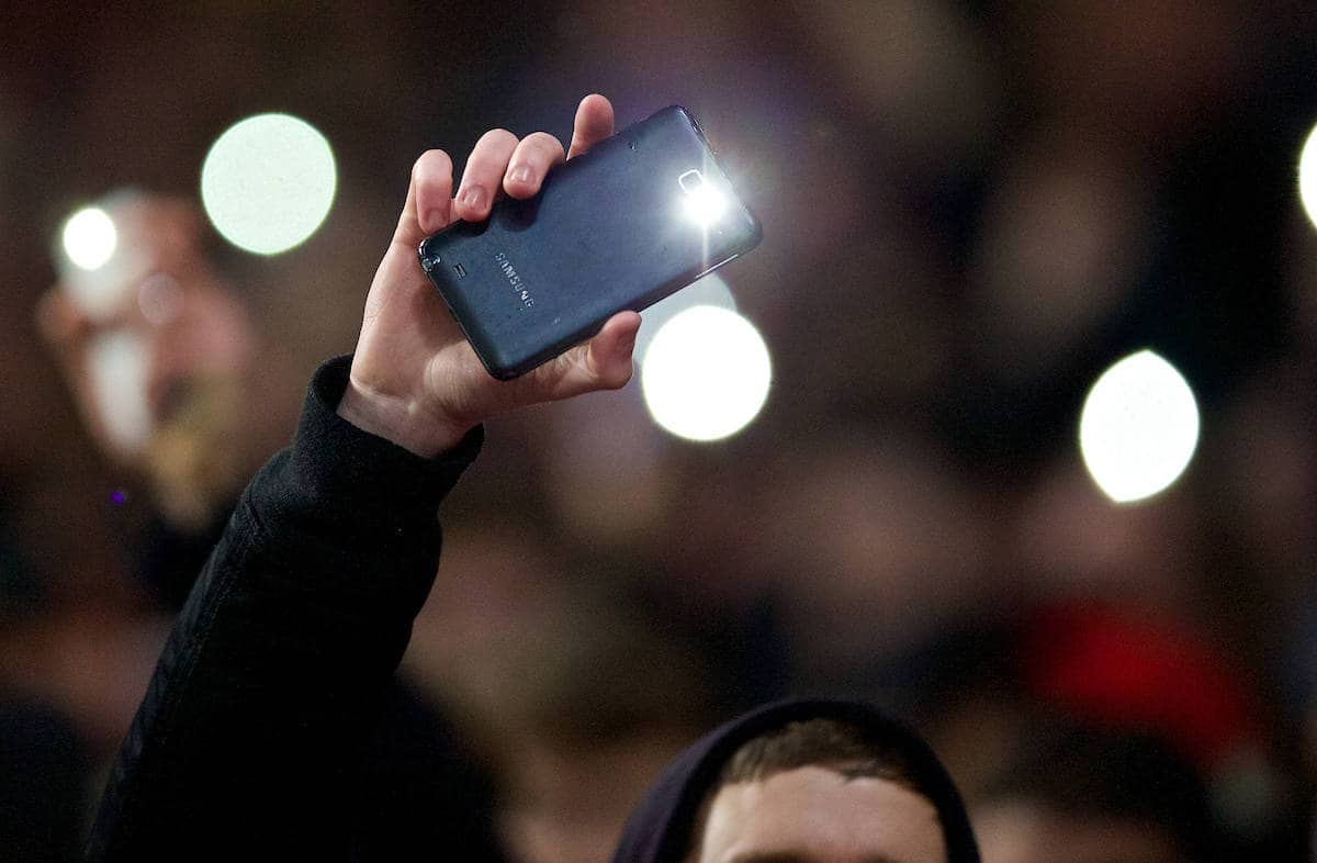 LONDON, ENGLAND - Friday, January 24, 2014: Fans use their mobile phone flashlights as part of the floodlights fail as Arsenal take on Coventry City during the FA Cup 4th Round match at the Emirates Stadium. (Pic by David Rawcliffe/Propaganda)