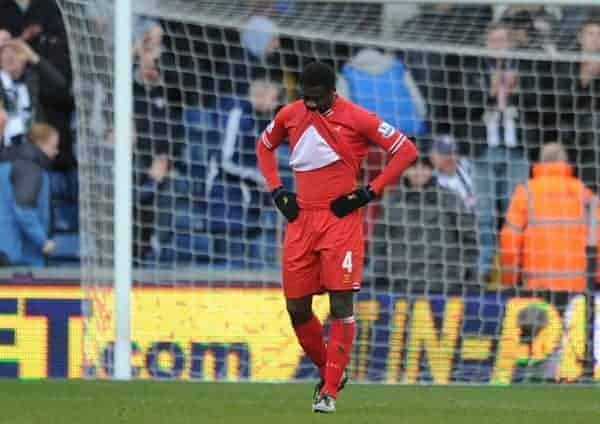 WEST BROMWICH, ENGLAND - Sunday, February 2, 2014: Liverpool's Kolo Toure looks dejected after his error cost his side two points, gifting West Bromwich Albion an equalising goal, during the Premiership match at the Hawthorns. (Pic by Chris Brunskill/Propaganda)