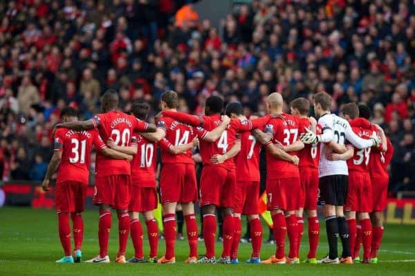 LIVERPOOL, ENGLAND - Saturday, February 8, 2014: Liverpool players stand to remember former player Tony Hateley before the Premiership match against Arsenal at Anfield. (Pic by David Rawcliffe/Propaganda)
