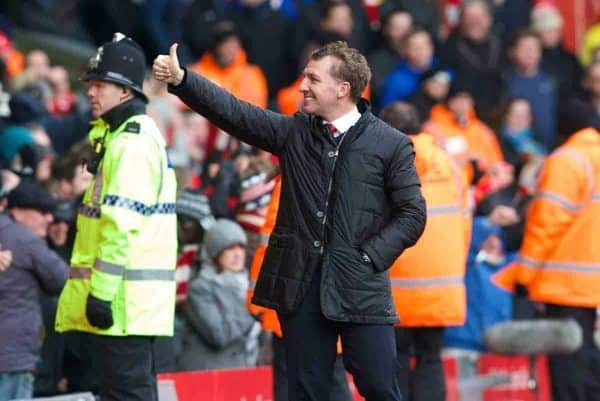 LIVERPOOL, ENGLAND - Saturday, February 8, 2014: Liverpool's manager Brendan Rodgers is all smiles as his side score the fifth against Arsenal during the Premiership match at Anfield. (Pic by David Rawcliffe/Propaganda)