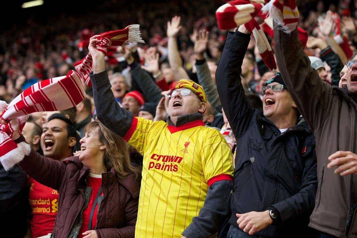 LIVERPOOL, ENGLAND - Saturday, February 8, 2014: Liverpool supporters celebrate as they watch the Reds thrash Arsenal 5-1 during the Premiership match at Anfield. (Pic by David Rawcliffe/Propaganda)