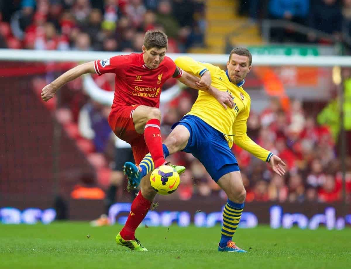 LIVERPOOL, ENGLAND - Saturday, February 8, 2014: Liverpool's captain Steven Gerrard in action against Arsenal'a Lukas Podolski during the Premiership match at Anfield. (Pic by David Rawcliffe/Propaganda)