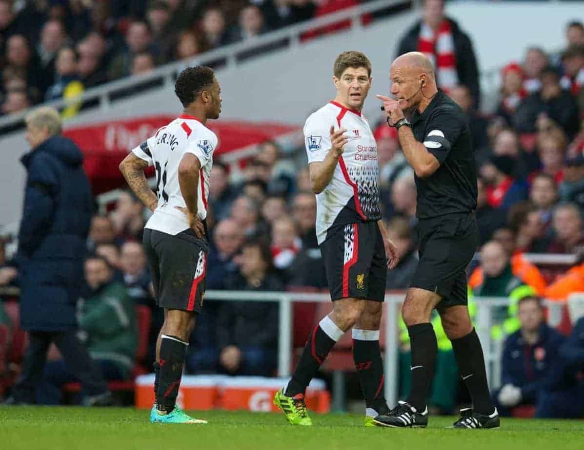 LONDON, ENGLAND - Sunday, February 16, 2014: Referee Howard Webb warns Liverpool's captain Steven Gerrard about Raheem Sterling during the FA Cup 5th Round match against Arsenal at the Emirates Stadium. (Pic by David Rawcliffe/Propaganda)