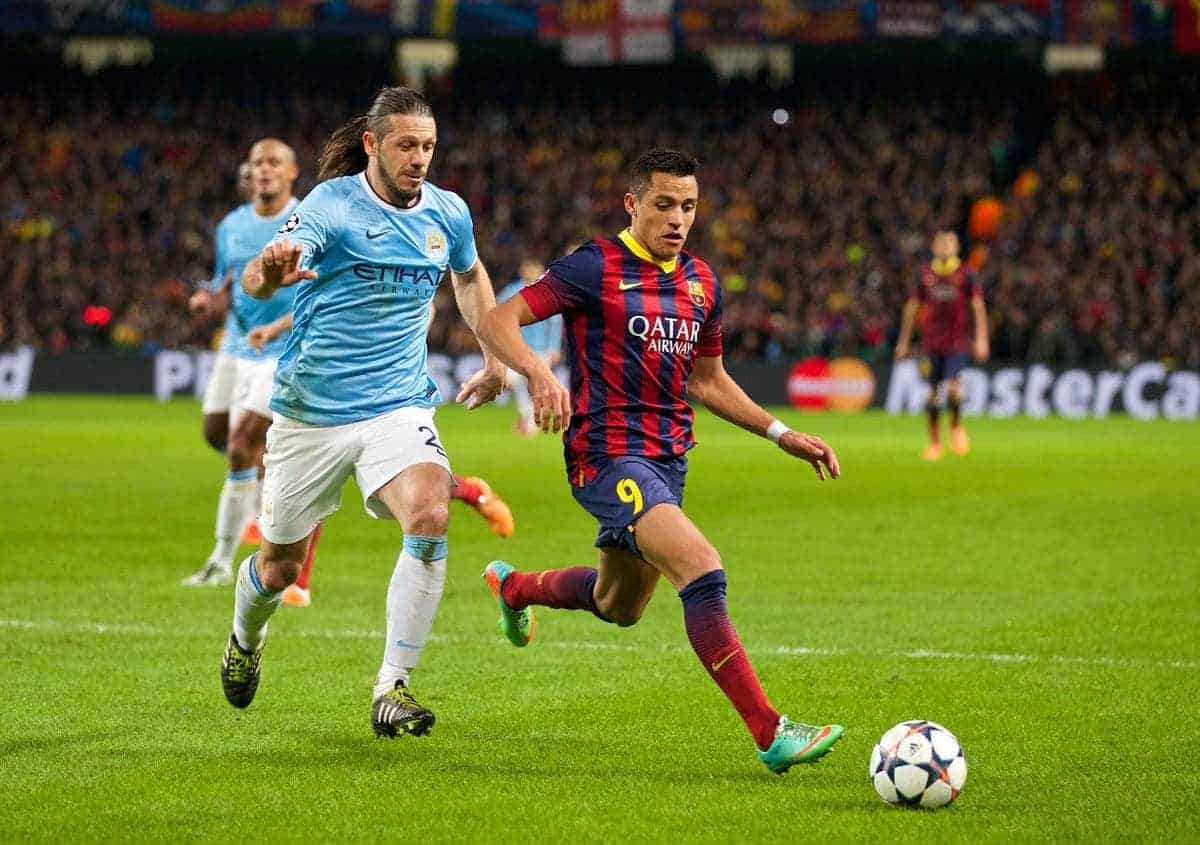 MANCHESTER, ENGLAND - Tuesday, February 18, 2014: Manchester City's Martin Demichelis in action against FC Barcelona's Alexis Sanchez during the UEFA Champions League Round of 16 match at the City of Manchester Stadium. (Pic by David Rawcliffe/Propaganda)