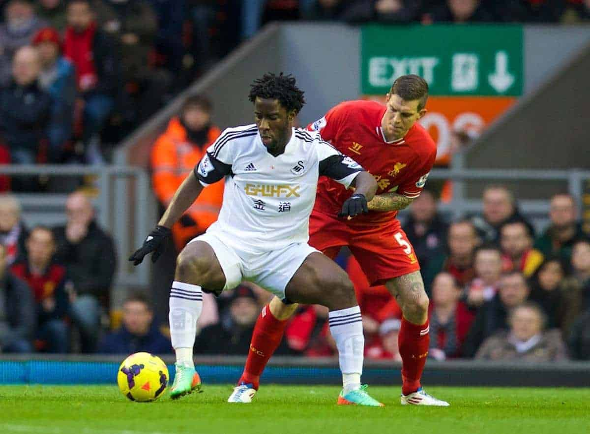 LIVERPOOL, ENGLAND - Sunday, February 23, 2014: Liverpool's Daniel Agger in action against Swansea City's Wilfried Bony during the Premiership match at Anfield. (Pic by David Rawcliffe/Propaganda)