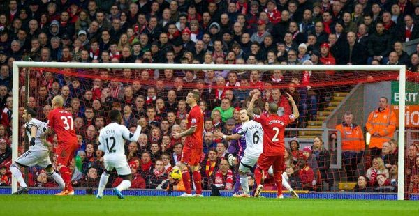 LIVERPOOL, ENGLAND - Sunday, February 23, 2014: Liverpool's Martin Skrtel scores an own-goal as Swansea City level the score 2-2 during the Premiership match at Anfield. (Pic by David Rawcliffe/Propaganda)