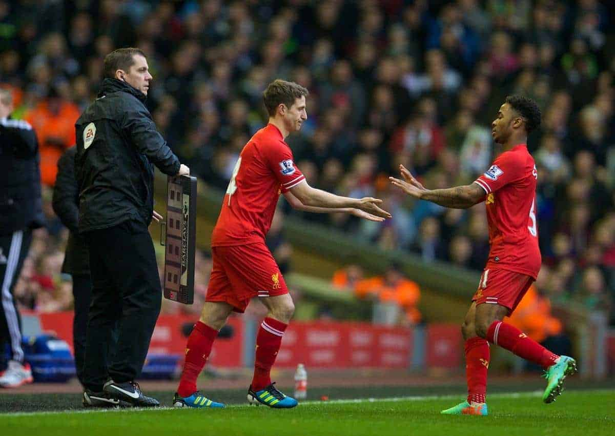 LIVERPOOL, ENGLAND - Sunday, February 23, 2014: Liverpool's Raheem Sterling is replaced by substitute Joe Allen during the Premiership match against Swansea City at Anfield. (Pic by David Rawcliffe/Propaganda)