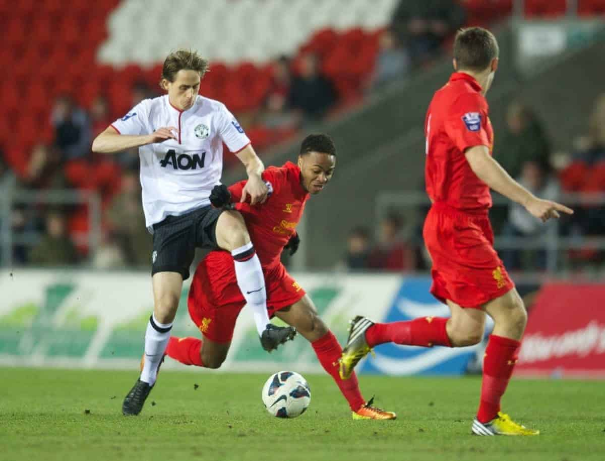 ST HELENS, ENGLAND - Monday, February 25, 2013: Liverpool's Raheem Sterling in action against Manchester United's Adnan Januzaj during the Premier League Academy match at Langtree Park. (Pic by David Rawcliffe/Propaganda)