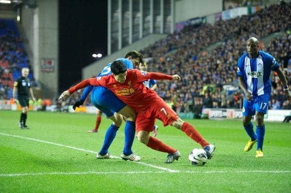WIGAN, ENGLAND - Saturday, March 2, 2013: Liverpool's Luis Alberto Suarez Diaz terrorises the Wigan Athletic defence during the Premiership match at the DW Stadium. (Pic by David Rawcliffe/Propaganda)