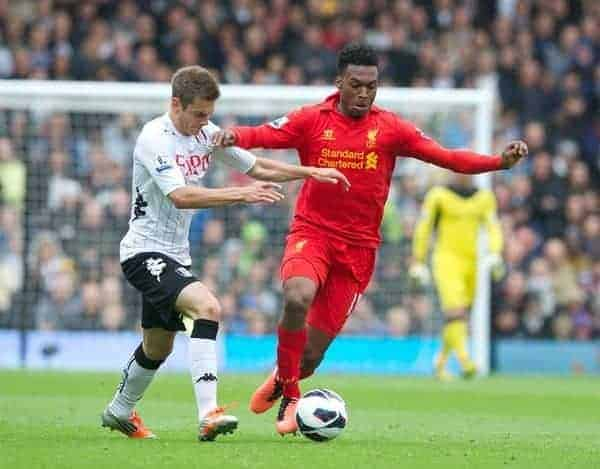 LONDON, ENGLAND - Sunday, May 12, 2013: Liverpool's Daniel Sturridge in action against Fulham's Alex Kacaniklic during the Premiership match at Craven Cottage. (Pic by David Rawcliffe/Propaganda)