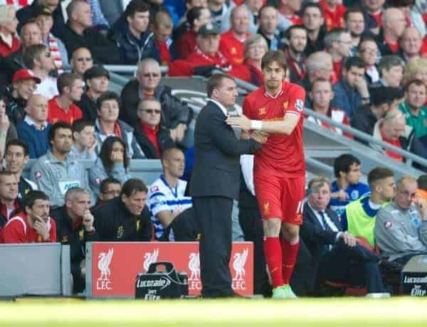 LIVERPOOL, ENGLAND - Sunday, May 19, 2013: Liverpool's substitute Sebastian Coates with manager Brendan Rodgers during the final Premiership match of the 2012/13 season against Queens Park Rangers at Anfield. (Pic by David Rawcliffe/Propaganda)