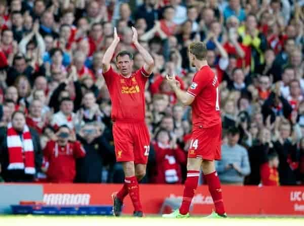 LIVERPOOL, ENGLAND - Sunday, May 19, 2013: Liverpool's Jamie Carragher applauds the supporters as he is substituted in his 737th and last game for the club during the final Premiership match of the 2012/13 season against Queens Park Rangers at Anfield. (Pic by David Rawcliffe/Propaganda)
