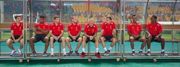JAKARTA, INDONESIA - Saturday, July 20, 2013: Liverpool players on the bench as they soak up the atmosphere before a preseason friendly against Indonesia XI at the Gelora Bung Karno Stadium. Joe Allen, Jordon Ibe, Jon Flanagan, Jay Spearing, Martin Skrtel, Jack Robinson, Raheem Sterling and Andre Wisdom. (Pic by David Rawcliffe/Propaganda)