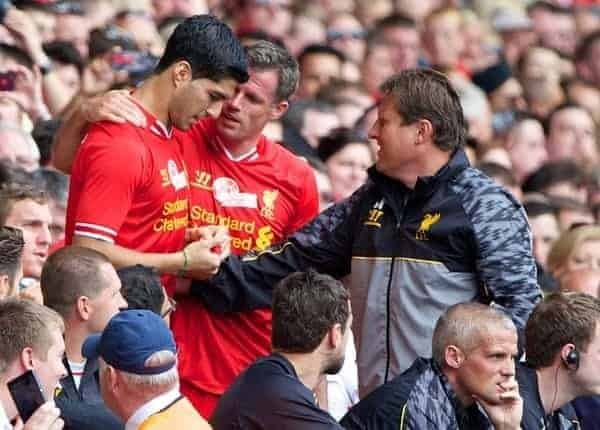 LIVERPOOL, ENGLAND - Saturday, August 3, 2013: Liverpool's Jamie Carragher and Luis Suarez during a preseason friendly match against Olympiakos CFP at Anfield. (Pic by David Rawcliffe/Propaganda)