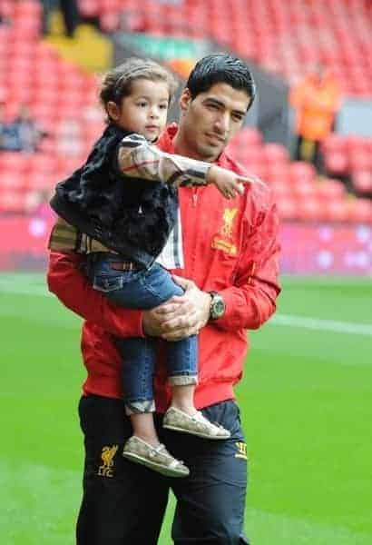 LIVERPOOL, ENGLAND - Saturday, August 17, 2013: Liverpool's Luis Suarez with his daughter Delfina before the Premiership match against Stoke City at Anfield. (Pic by David Rawcliffe/Propaganda)