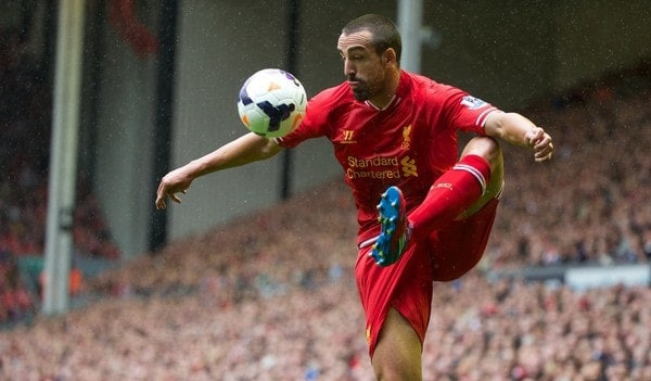 LIVERPOOL, ENGLAND - Saturday, August 17, 2013: Liverpool's Jose Enrique in action against Stoke City during the Premiership match at Anfield. (Pic by David Rawcliffe/Propaganda)