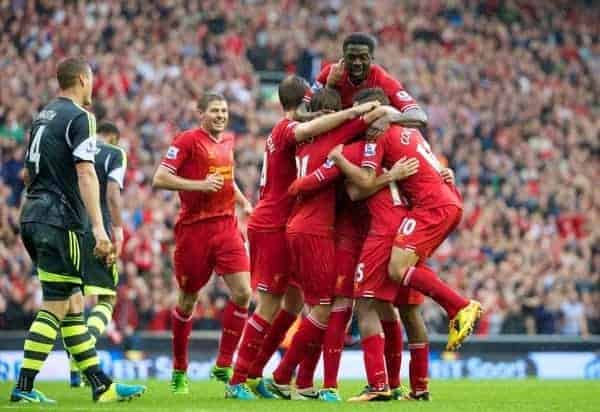 LIVERPOOL, ENGLAND - Saturday, August 17, 2013: Liverpool's Daniel Sturridge celebrates with team-mates after scoring the first goal against Stoke City during the Premiership match at Anfield. (Pic by David Rawcliffe/Propaganda)