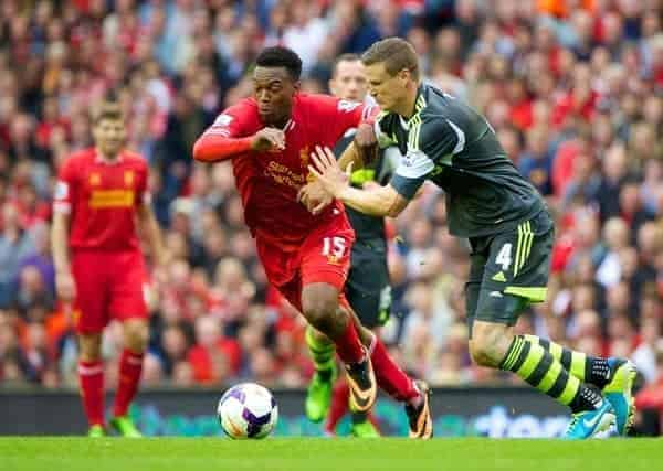 LIVERPOOL, ENGLAND - Saturday, August 17, 2013: Liverpool's Daniel Sturridge and Stoke City's Robert Huth during the Premiership match at Anfield. (Pic by David Rawcliffe/Propaganda)