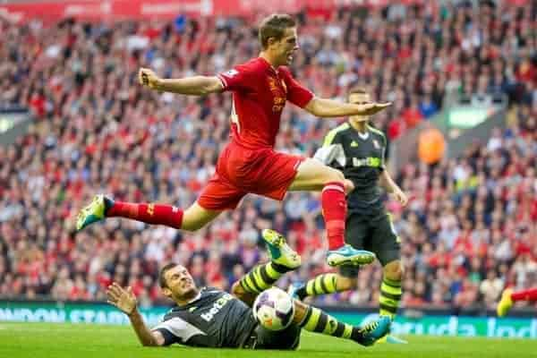 LIVERPOOL, ENGLAND - Saturday, August 17, 2013: Liverpool's Jordan Henderson and Stoke City's Erik Peters during the Premiership match at Anfield. (Pic by David Rawcliffe/Propaganda)